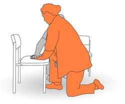 5. Assist client into a half kneeling position.