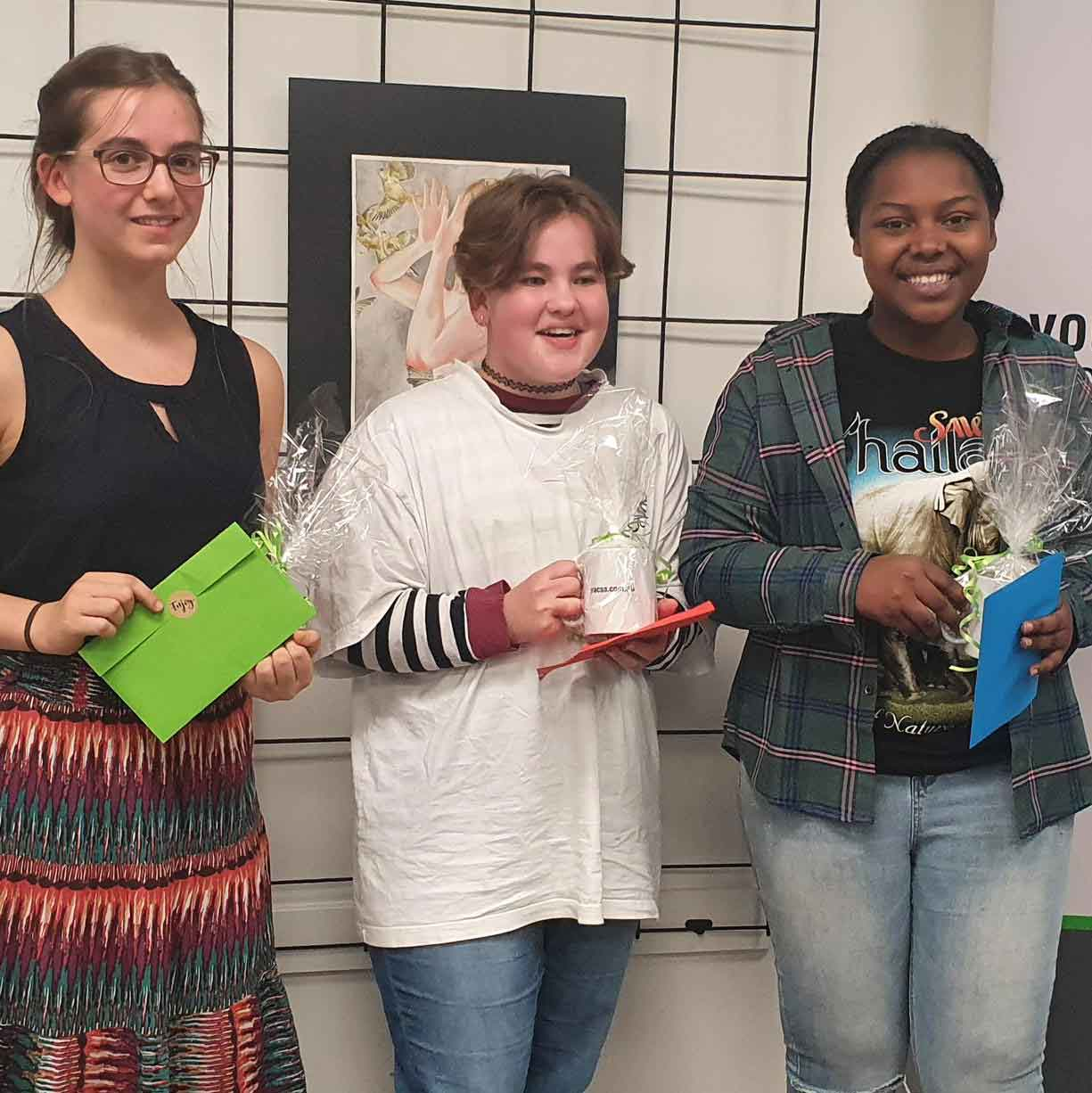All Youth Week artwork winners (L-R) Levant, 17 (3rd Prize), Sophie, 14 (2nd Prize), Faraja, 17 (1st Prize)