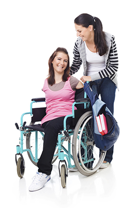 A young woman provides assistance to another young woman in a wheelchair