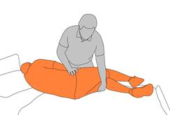 2. Slide client's legs off bed.