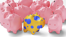 A wildly decorated piggybank stands out from the crowd of ordinary pink piggybanks