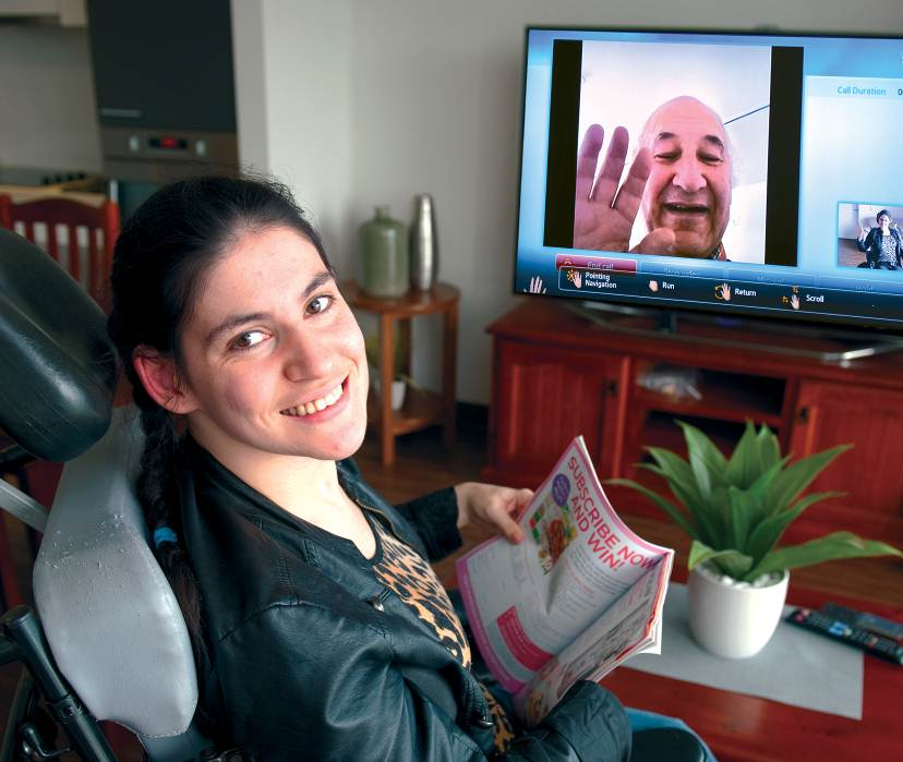 Woman using smart technology in her apartment