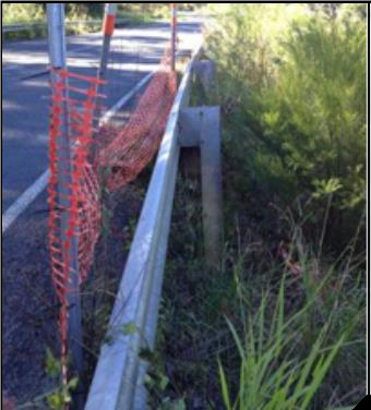 A fence provides a straight edge against which the extent of the landslip can be seen.