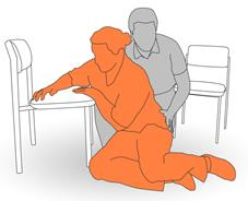 4. Place client's arm and opposite hand on to chair for support and assist to move into a kneeling position - part 2.